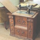 Singer Sewing Machine In Wooden Cabinet
