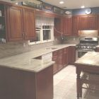 Cherry Cabinets With White Granite Countertops